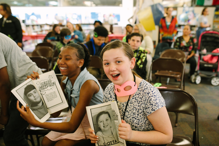 Unique Barne and Hailey Jackson hold their copies of In the Clouds Over Ypsilanti.