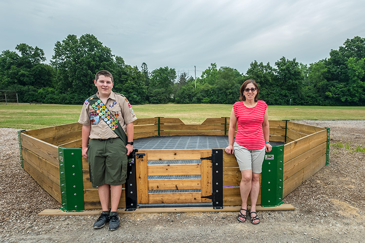Josh and Jenn Carlson with the Gaga Pit they built with the help of Next Door