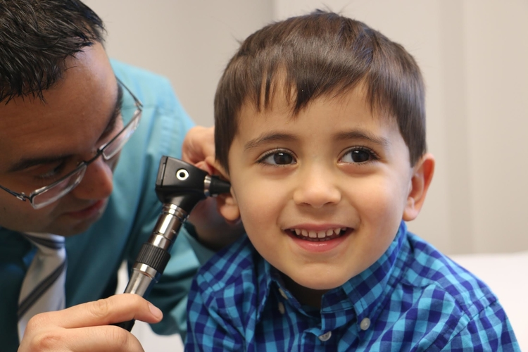 A practitioner examines his son at last year's Healthy Kids Fair.