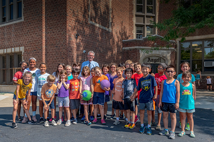 Principal Gary Court with students at Angell Elementary