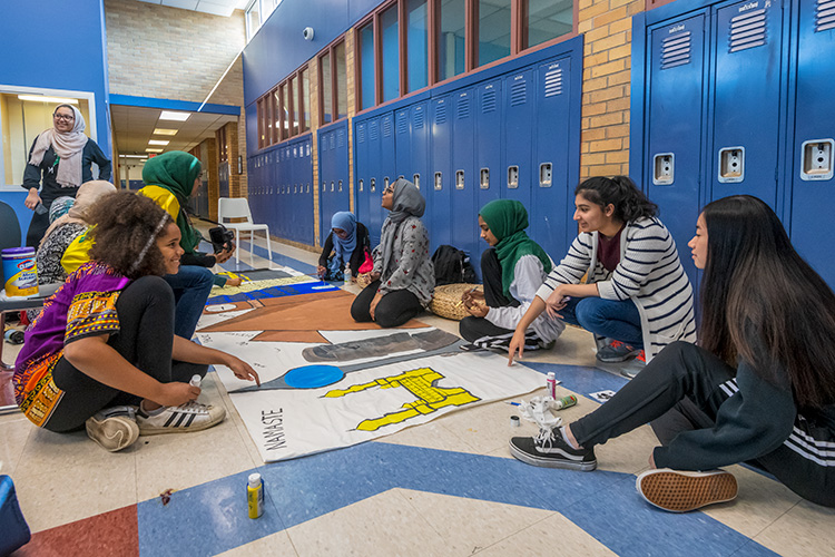 WiHi's Muslim Student Association painting a mural for WiHi's 8th International Dinner