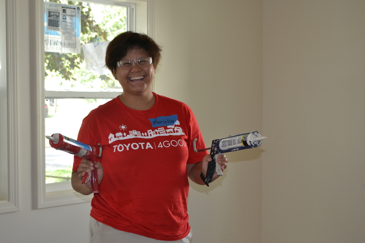 A Toyota volunteer works on a Habitat for Humanity house in Ypsi Township.
