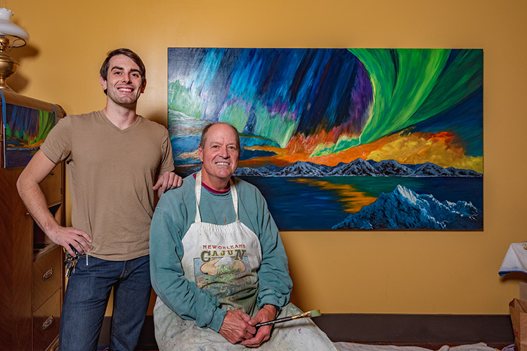 Patton Doyle with his uncle J Robert Doyle and one of his paintings at Decode Ypsilanti