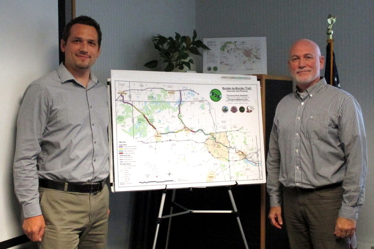 Peter Sanderson and Coy Vaughn with a map of the B2B Trail.