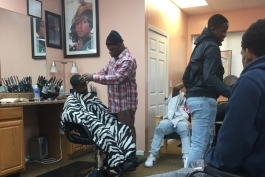 A Brother to Brother mentee gets a haircut from Shawn Green, Brother to Brother mentor and owner of Finesse 1 barbershop.
