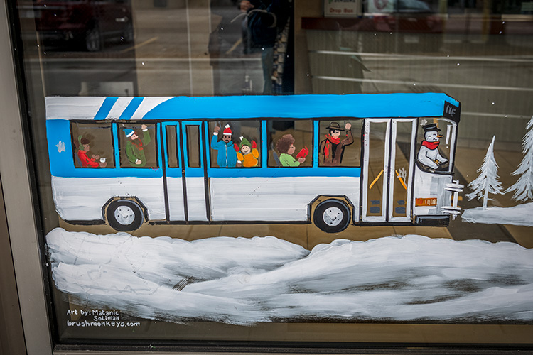 A Brush Monkeys holiday window painting at the Blake Transit Center
