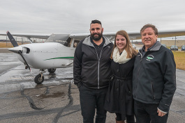 Tom Simon, Anna Buchel and Jerard Delaney at the Eagle Flight Centre at Willow Run Airport