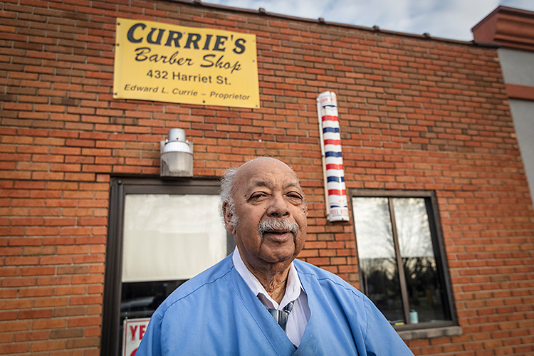 Owner Edward Currie outside Currie's Barber Shop