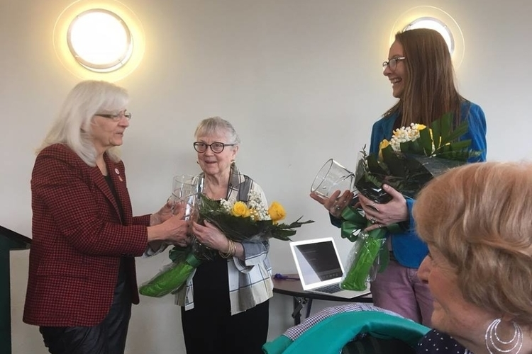 "Cheryl Farmer presents Jane Bird Schmiedeke and a relative of Nathalie ""Nat"" Edmunds with the 2018 Starkweather Award."
