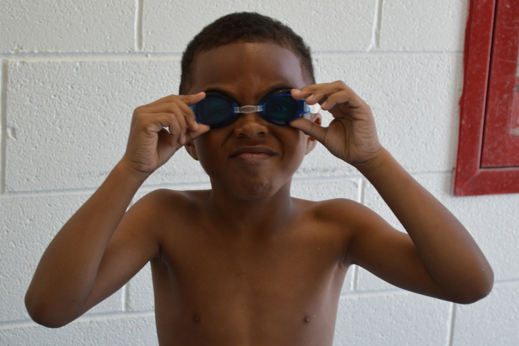 A Rutherford Pool visitor tests out new swim goggles.