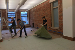 Workers renovate Revalue's new office space.