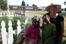 YDL-Superior branch manager Mary Garboden poses with kids at the branch's garden in 2016.