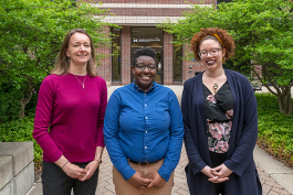 Katie Lopez, Raivynn Smith, and Kaisha Brezina at the U of M School of Social Work.