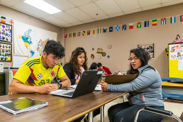 Diana Bernal-Canseco (right) of Buenos Vecinos helping students in an ESL class at YCHS.