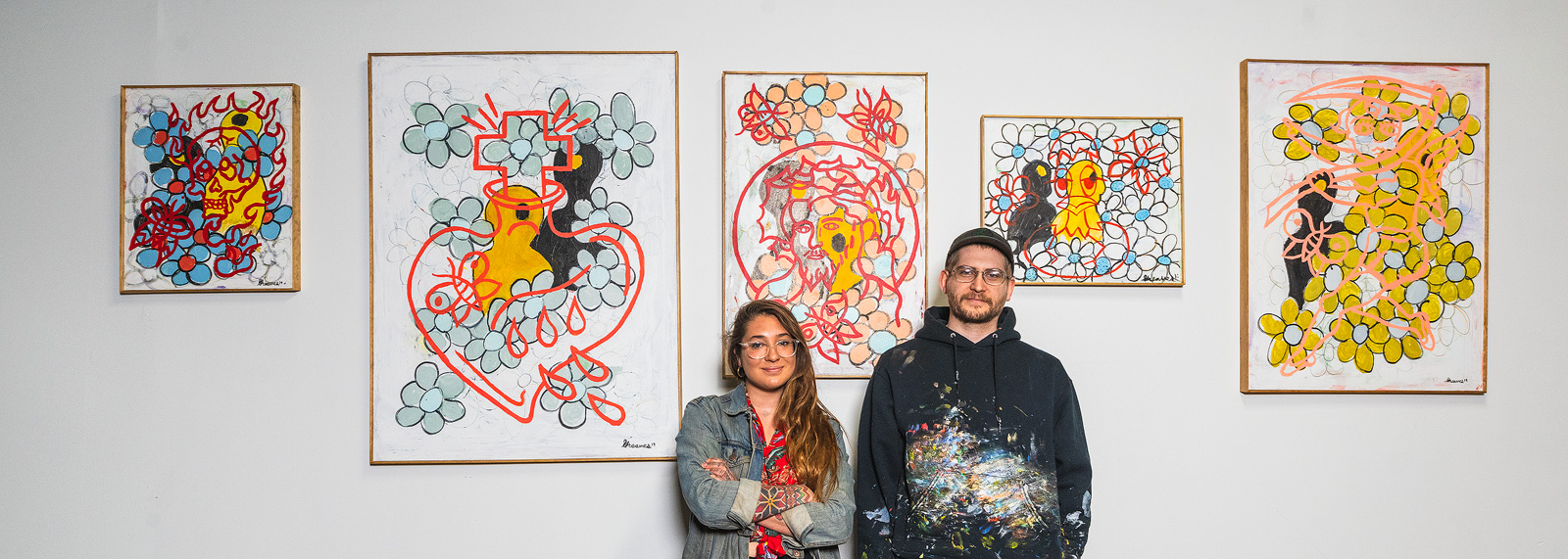 Anya Klapischak with Brennan Greaves and his paintings at The Hosting.