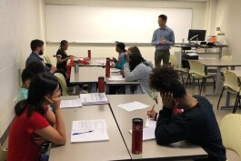 Concentrate managing editor Patrick Dunn leads a writing workshop with Upward Bound students.