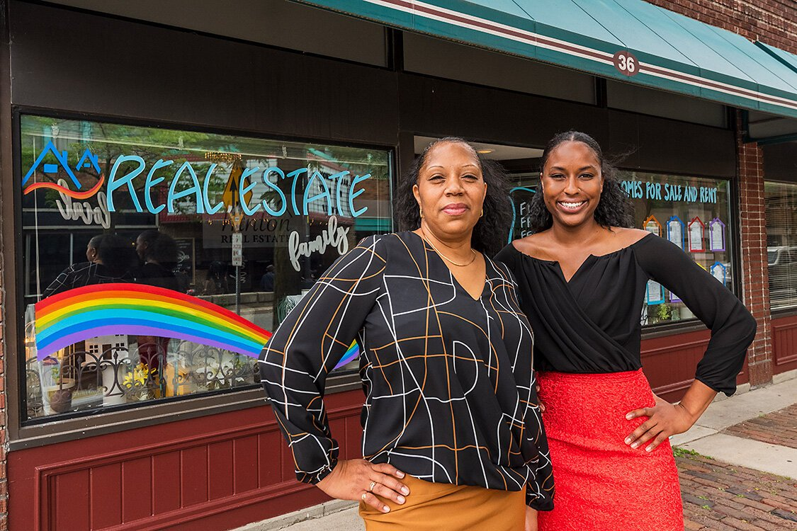 Candye Hinton and her daughter Kayia Hinton outside of Hinton Real Estate in downtown Ypsilanti.