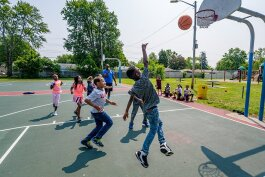 A game of basketball during Y on the Fly in West Willow Park.