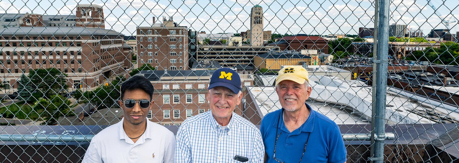Kazi Najeeb Hasan, Peter Allen, and Doug Kelbaugh at a potential development site on top of the Liberty Square parking structure.