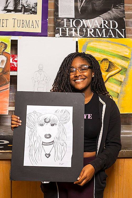 YCS student Kiayre Cook with her art work.