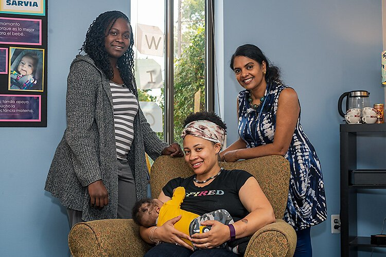 Dera Williams, Najma Treadwell with her son Jahleel, and Gayathri Akela at the breastfeeding lounge at the Washtenaw County WIC office.