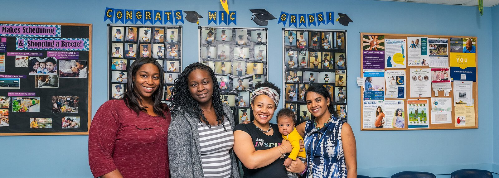 Ronda Tredway, Dera Williams, Najma Treadwell with son Jahleel, and Gayathri Akella at the Washtenaw WIC office.