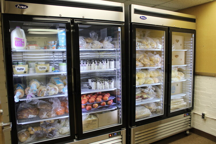 A refrigerator and freezer in the food pantry at Community Action Network's Brick Community Center, funded by a county grant.