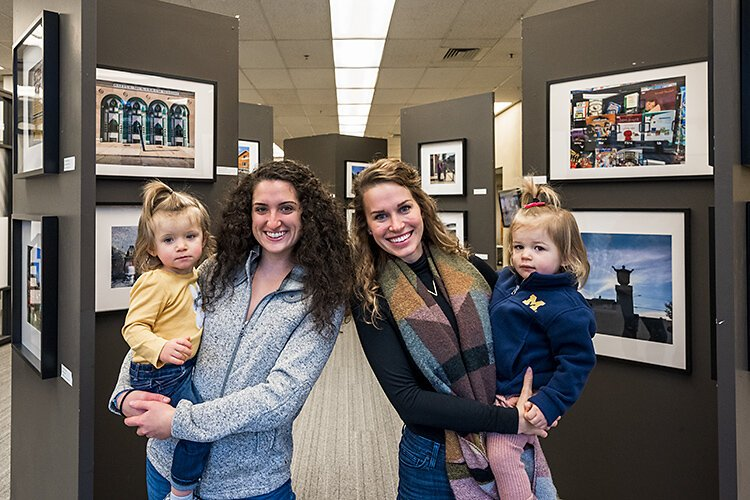 Kerrigan Fitzpatrick and Alyssa Shumaker of optiMize with their daughters.
