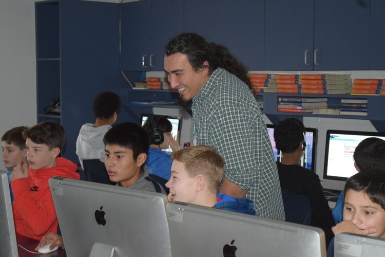 Herb Torres of Hook Studios works with Tappan Elementary students during last year's Hour of Code.