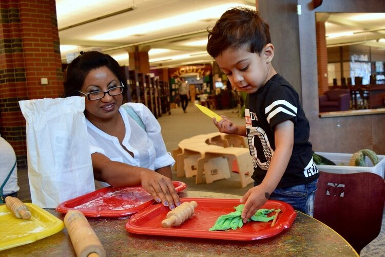 A child makes homemade clay at last year's preschool resource fair.