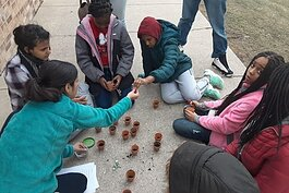 Since November 2019, A2Zero has held multiple community engagement events to discuss action planning and hear public feedback for becoming carbon neutral in 2030. Here, local students plant flowers as part of this community engagement campaign.