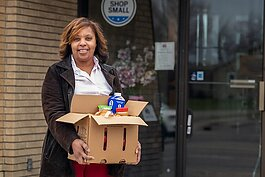Khadija Wallace hands out meals at Joyful Treats Community Development.