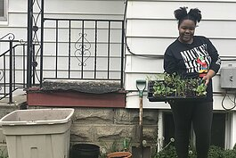 Growing Hope client Teria Moore-Berry recently received several containers for gardening.