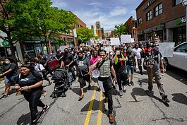 Protestors march through downtown Ann Arbor.