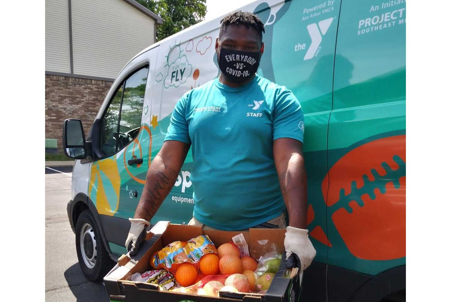 With funding from the U.S. Department of Agriculture, Ann Arbor YMCA has been distributing produce boxes weekly for families in need during the pandemic.