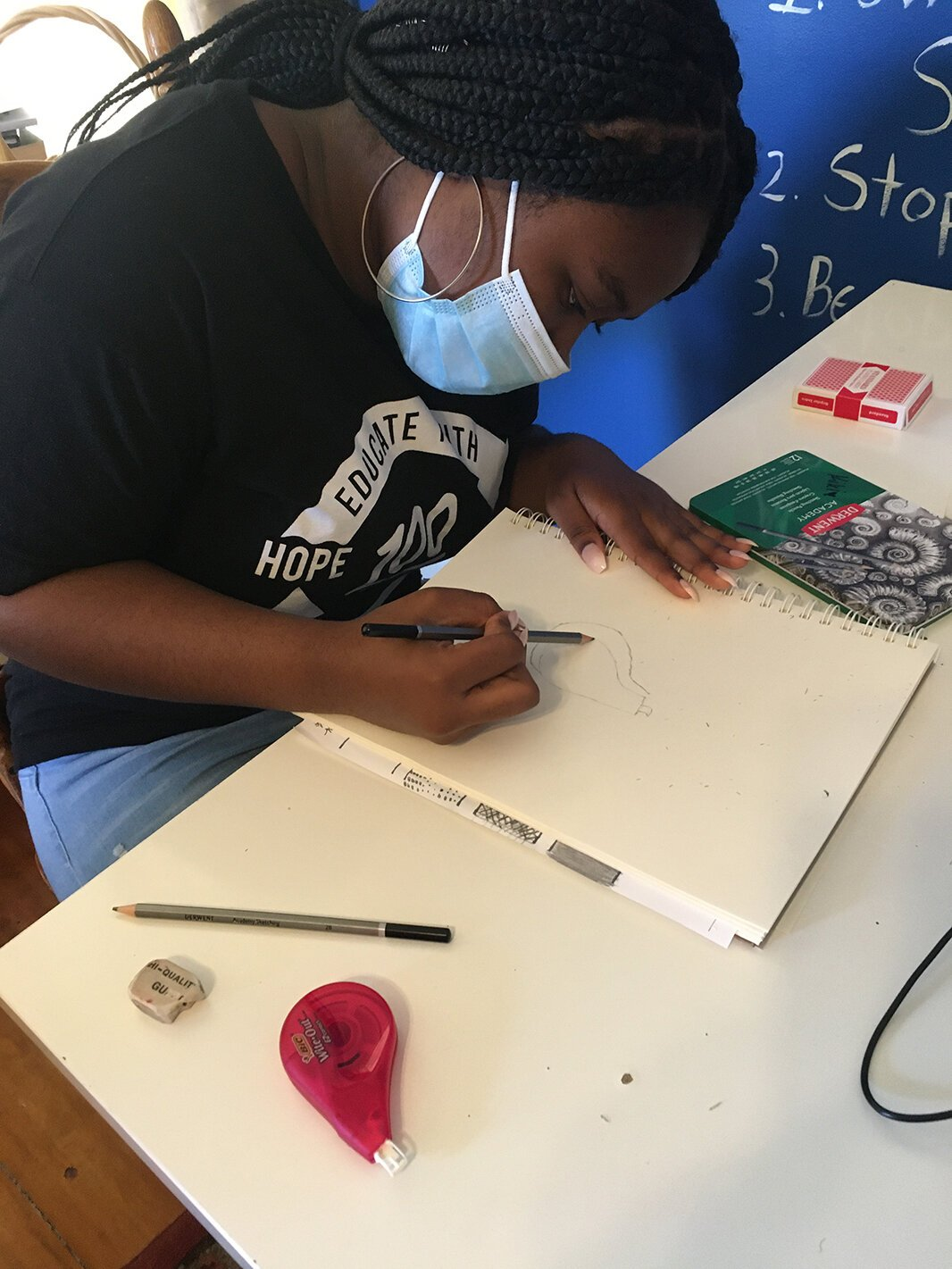 Kierra Owens participates in art class at Educate Youth's clubhouse.