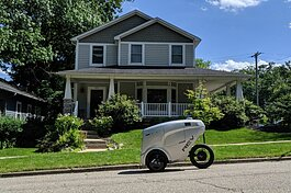 A Refraction AI REV-1 robot makes a delivery.