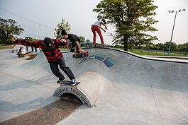 People skate at the Ypsilanti Township CommUNITY Skatepark.