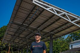 Dave Strenski in front of a solar installation at the Thompson Block in Ypsilanti.