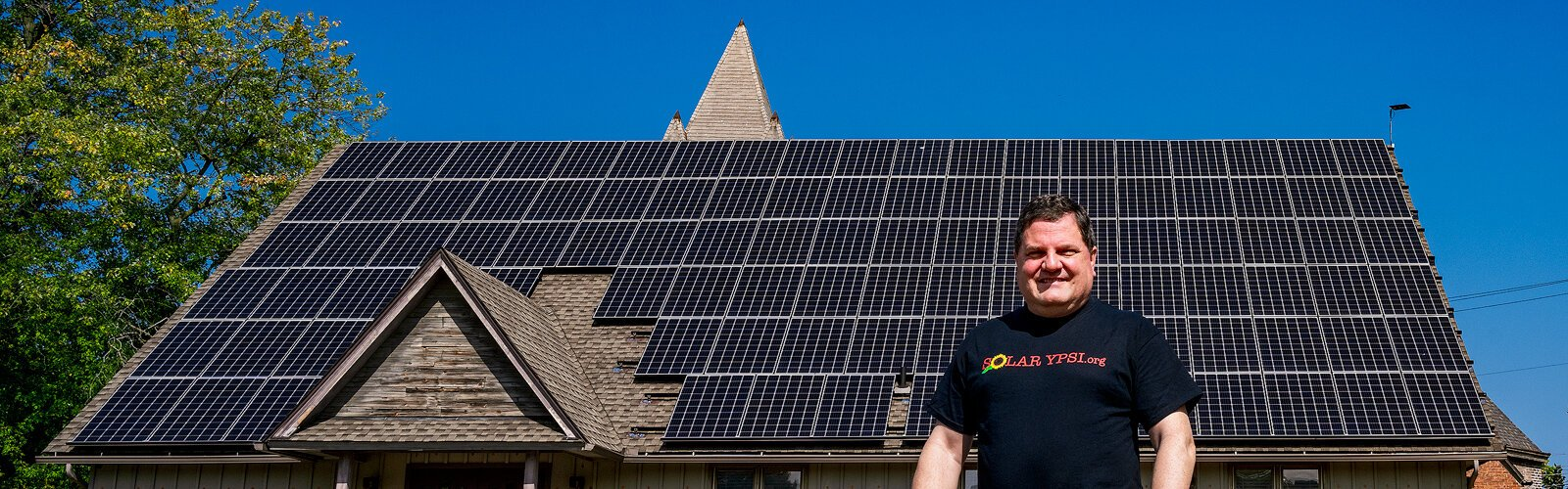 Steve Pierce stands in front of the solar roof at The YPSI.