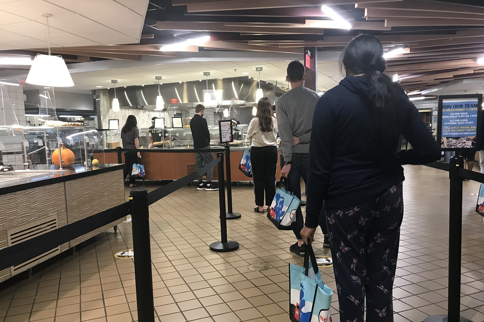 Students line up at a U-M dining hall.