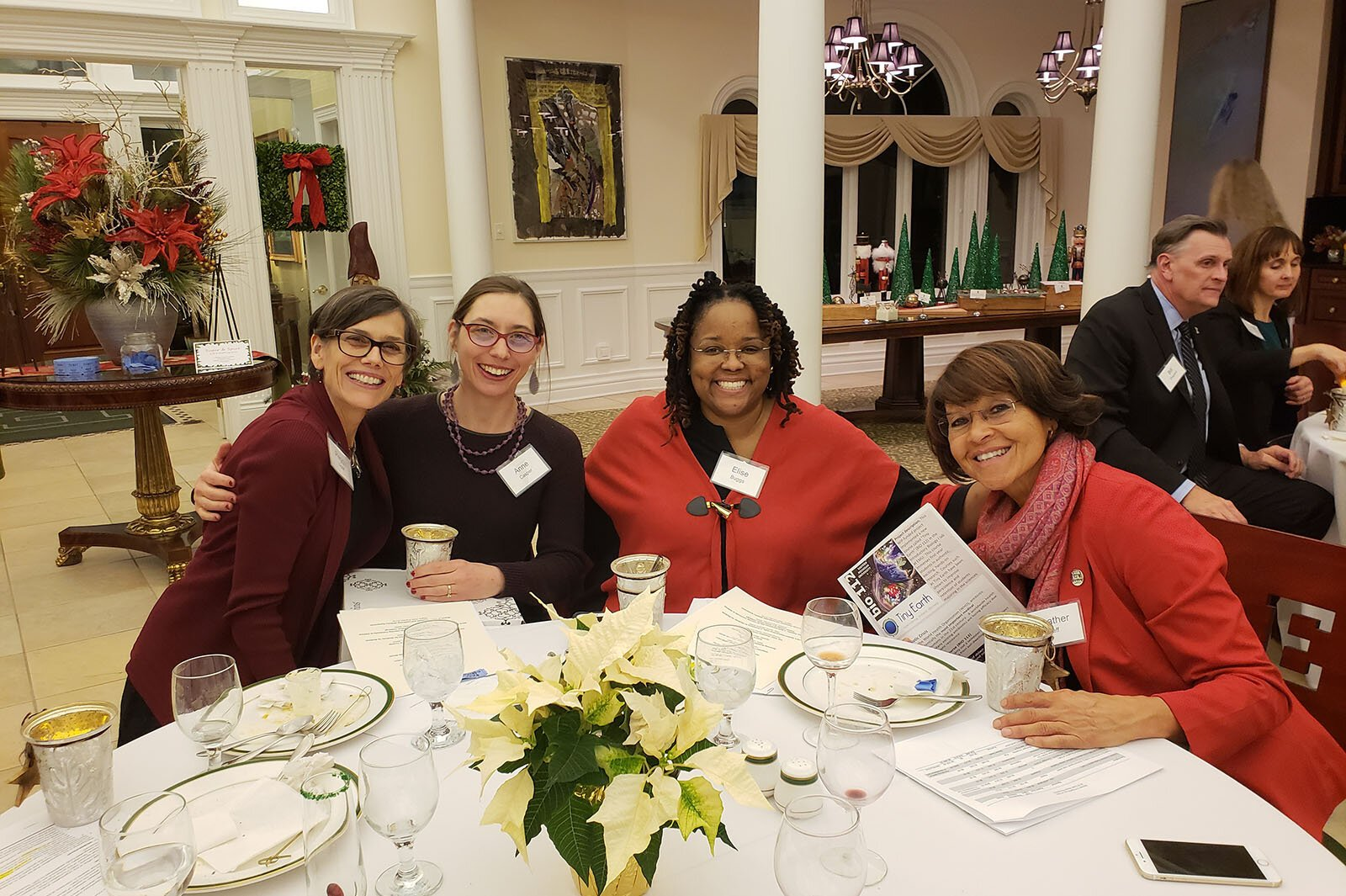 Women in Philanthropy members Peggy Liggit, Anne Casper, Elise Buggs, and Heather Neff at the group's fall 2019 meeting.