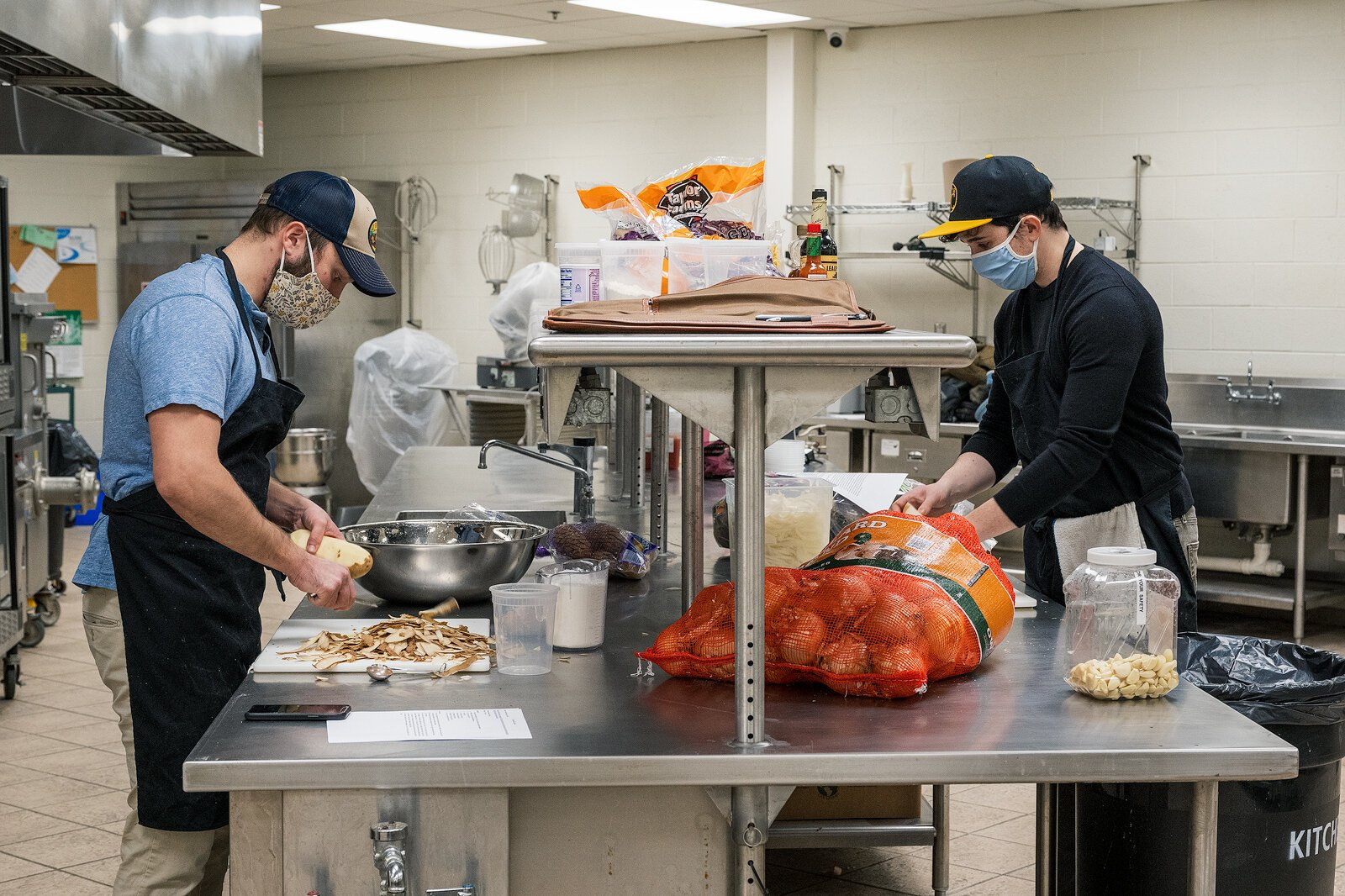 Forrest Maddox and Bryan Santos, owners of the White Pine Kitchen, prepare food.