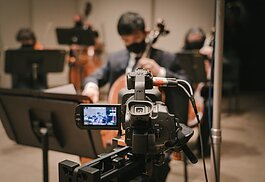 Cellist Benjamin Francisco performs at an Ann Arbor Symphony Orchestra concert being filmed for viewing online.