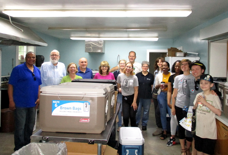 YMOW staff and volunteers gather in the kitchen at First Baptist Church before making their first Saturday delivery in 14 years.