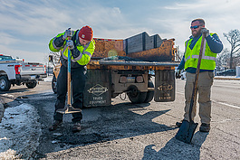 Matt Rikerwe and Devin Holtmeyer fix a pothole in Ferndale