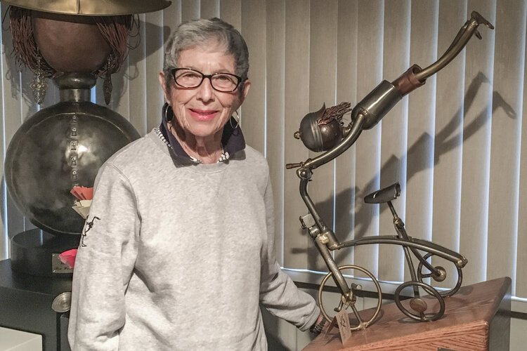 Rose Wunderbaum Traines stands with one of her metal sculptures – one which won an award in New York at the Salmagundi Club.