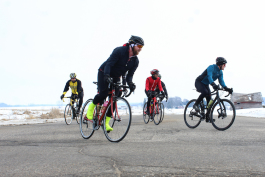 A group of cyclists rides through Mount Pleasant on March 9, 2019.