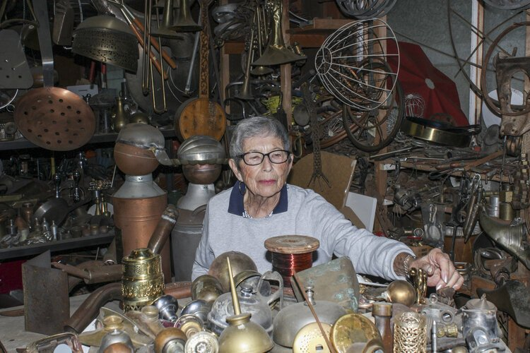 Mount Pleasant resident Rose Wunderbaum Traines looks through various pieces of metal in her garage.