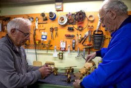 Don Hire, Secretary of the Mid-Michigan Woodcrafters Club, and Tom Delia, President of the Mid-Michigan Woodcrafters Club, inspect some of the toys that have already been made to give to charity at Christmas this year.